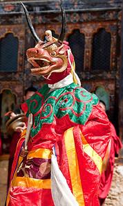 A horned figure in fancy dress for a local teschu